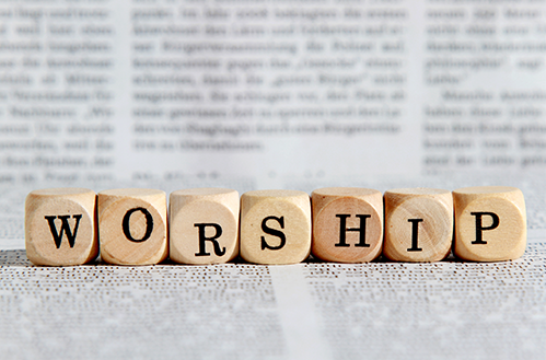 Brown wooden blocks with letters. spelling out the word worship